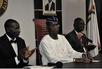 Lagos State Governor, Mr. Babatunde Fashola SAN (middle) and the Attorney-General and Commissioner for Justice, Mr. Ade Ipaye (right)