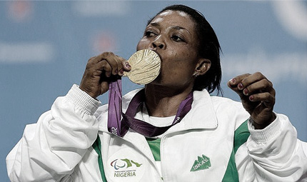 Gold medallist Esther Oyema of Nigeria kisses her medal