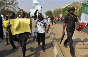 Demonstrators protest the elimination of a fuel subsidy