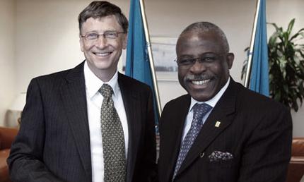 Bill Gates smiles next to IFAD President Kanayo F. Nwanze