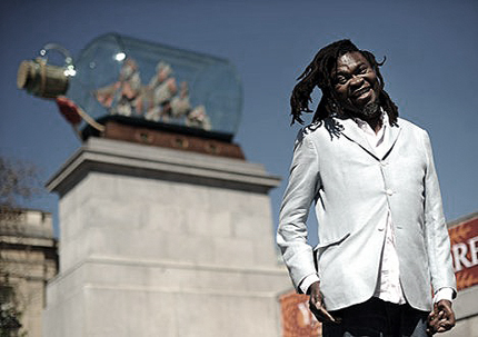 Yinka Shonibare MBE with Nelson's ship in a bottle on Trafalgar Square